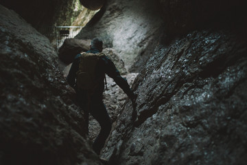 A man hiking in a cave