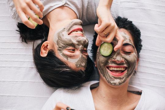 Two friends having fun having beauty treatment