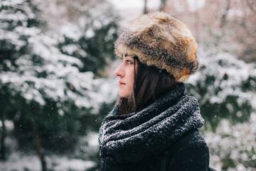 Portrait of a beautiful brunette woman with fur hat