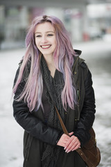 Happy young woman with pastel hair smiling