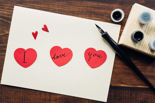 """I love you"""" message hand written on red paper hearts""""""""I love you"""" message hand written on red paper hearts"""""""" love you"""" message hand written on red pa""""""""love you"""" message hand written """"""""ove you"""" message hand """"""""ve you"""" messag""""""""e you"""" """""""" """""""