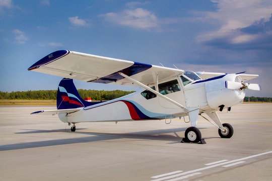 Duster, small old plane for agricultural spraying, flying in the sky