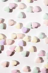 Valentine: Candy Hearts Scattered On White Paper