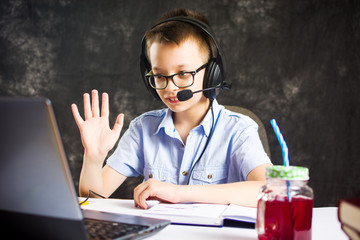 Boy having a video call with headset