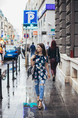Beautiful fashionable young woman in the city