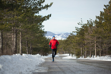 Running on a mountain road during the winter day