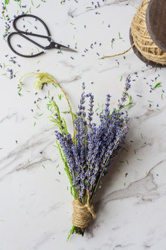 making a dried flower bunch with lavender