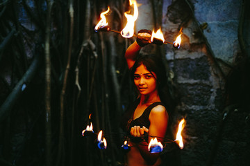 Pretty fire performer with hand flames