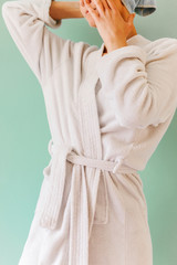 Woman in a white bathrobe