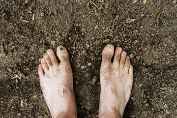 Dirty Barefoot in Soil