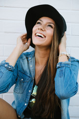 Cute and trendy young woman smiling