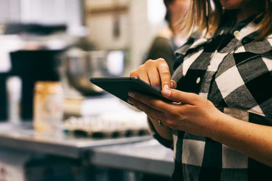 Bakery: Baker Using Digital Tablet To Check Recipe