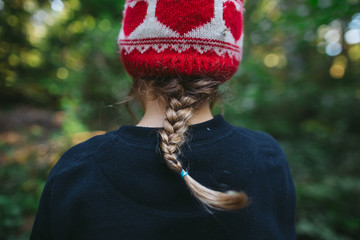 Back view of young girls braid and toque