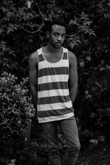 African american young man with stripes shirt in black and white