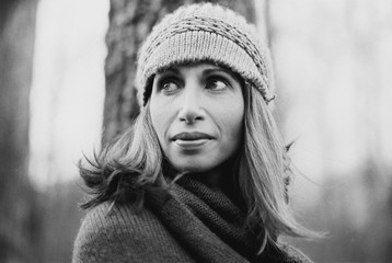 Black and white portrait of a beautiful woman in a beanie