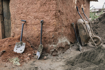 Dirty shovels and wheel barrow in Africa