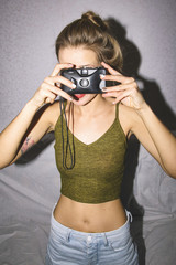 Woman holding old film camera
