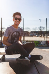 Cheerful Young Skateboarder Portrait at the Skatepark