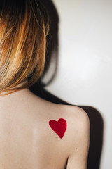 Red Heart Drawing on the Female Shoulder