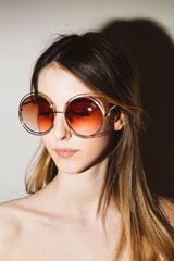 Portrait of a Pretty Young Woman With Retro Sunglasses