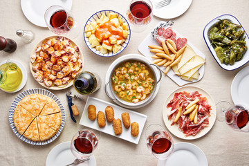 Spanish tapas with variety of dishes on white table