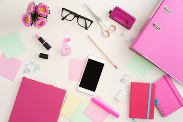 Collection of feminine desktop office objects