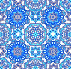 Floral ethnic tiled ornament in blue color. Flower geometric ornamental background.Decorative ornament for fabric, textile, wrapping paper, scrapbooking