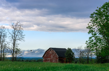 old red barn on a spring day