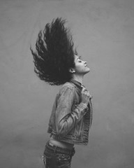 Young Woman Flipping Her Hair Back