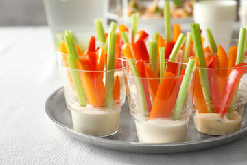 Delicious appetizers for baby shower on metal plate