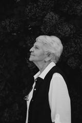 Portrait of happy senior woman outside in garden