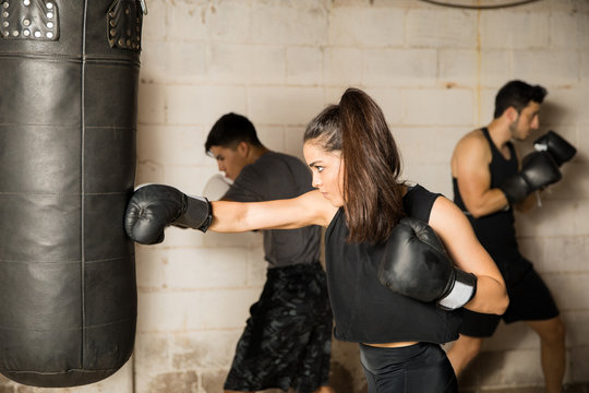 Female boxer training in a gym