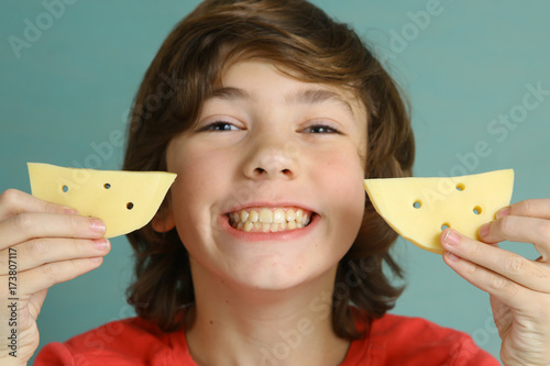say cheese smile teenager boy with two cheese piece close up smiling