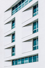 Abstract White Facade with Blue Windows