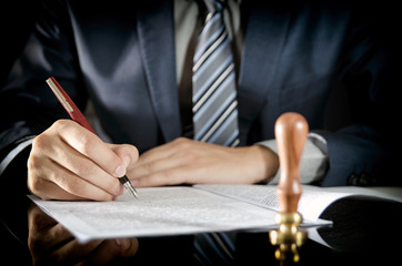 Lawyer signing contract, notary public, businessman agreement