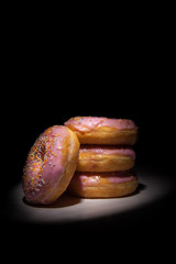 doughnuts on a black background
