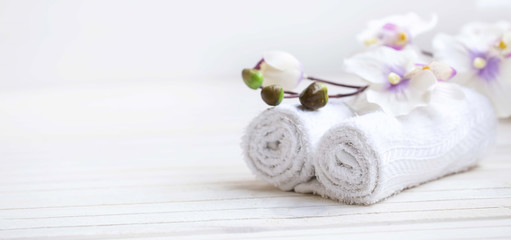 SPA setting with bath towels and orchid flower, selective focus