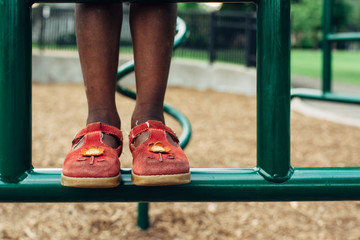 African American girl's feet at a playground