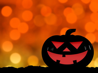 silhouette of halloween pumpkin on hill with defocused orange and yellow lights bokeh background, close up funny face of jack o lantern smiling scary