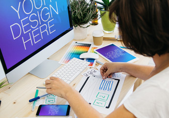 Web Designer with 3 Devices Mockup 1
