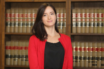 Portrait of a young female professional, woman lawyer in law library
