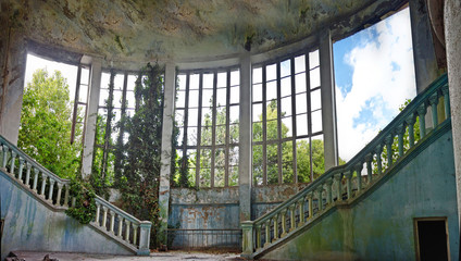Abandoned and overgrown interior of old mansion in Abkhazia