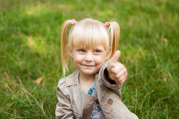Cute little girl show thumb up