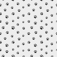 Cat paw track. Seamless animal pattern of paw footprint. Vector