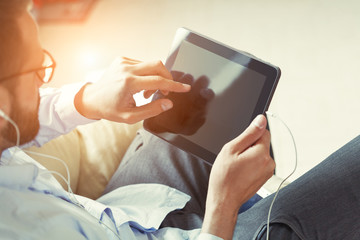 businessman with digital tablet and earphones