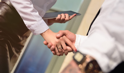 handshake between a business man and a business woman. negotiations, a transaction, a meeting, a business, the signing of a contract.