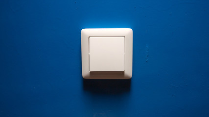 Power button on a blue wall
