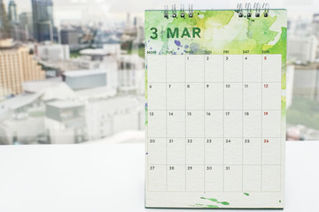mock up calendar of March on office desk for meeting and appointment reminder