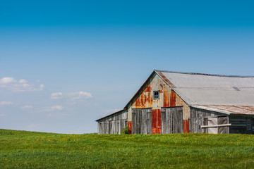 perfect old farm with blue sky and green pasture