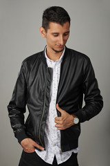 Young man in black leather jacket